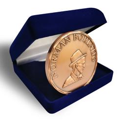 metal souvenir coin - Norman Borlaug